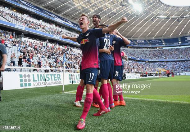 Joshua Kimmich of RB Leipzig celebrates with his teammates after Denis Thomalla of RB Leipzig scored his team's third goal during during the Second...