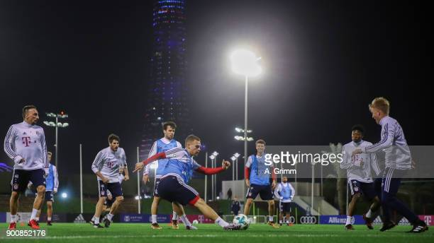 Joshua Kimmich passes the ball during a training session on day 2 of the FC Bayern Muenchen training camp at ASPIRE Academy for Sports Excellence on...