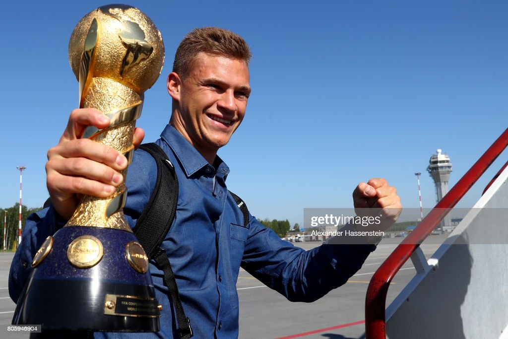 Joshua Kimmich presents the FIFA Confederations Cup 2017 trophy prior to the departure of Germany at Sankt Petersburg Pulkovo Airport Airport on July 3, 2017 in Saint Petersburg, Russia.
