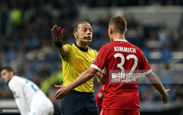 Joshua Kimmich protest to referee during the UEFA Champions League Semi Final Second Leg match between Real Madrid and Bayern Munchen at the Santiago...
