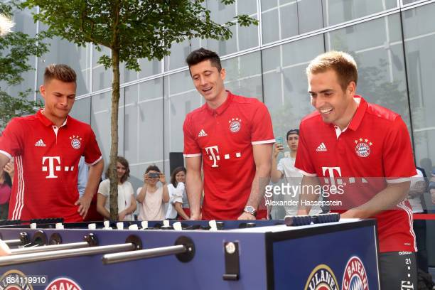 Joshua Kimmich Robert Lewandowski and Philiip Lahm of FC Bayern Muenchen play a fun table top football match at Paulaner headquarter Munich on May 17...