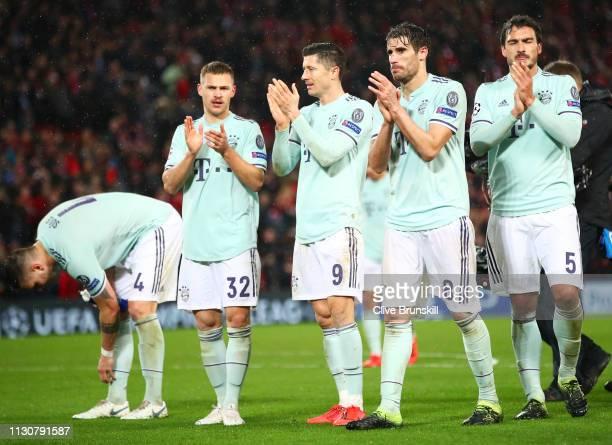Joshua Kimmich Robert Lewandowski Javi Martinez and Mats Hummels of Bayern Munich applaud the travelling fans after the UEFA Champions League Round...