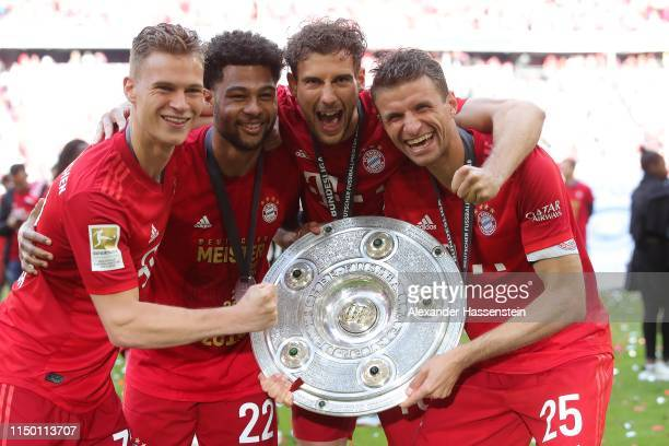 Joshua Kimmich Serge Gnabry Leon Goretzka and Thomas Mueller of FC Bayern Munich celebrate with the trophy following the Bundesliga match between FC...