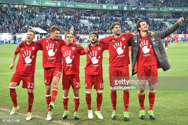 Joshua Kimmich Thomas Mller Philipp Lahm Juan Bernat Juan Bernat and Mats Hummels of Muenchen celebrate winning the Bundesliga title after the...