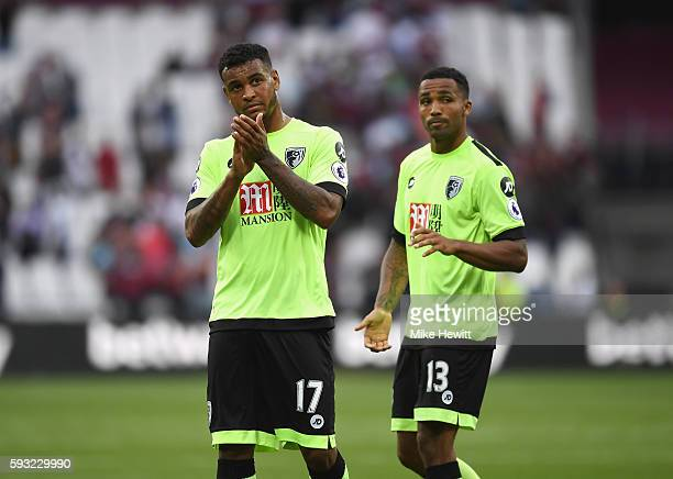 Joshua King and Callum Wilson of AFC Bournemouth applaud the fans after the Premier League match between West Ham United and AFC Bournemouth at...