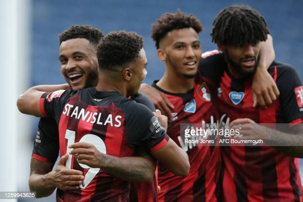 Joshua King congratulates teammate Junior Stanislas of Bournemouth after he scores a goal to make it 31 during the Premier League match between...