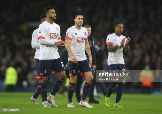 Joshua King Dan Gosling and Nathaniel Clyne of AFC Bournemouth look dejected in defeat after the Premier League match between Everton FC and AFC...