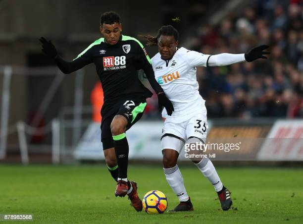 Joshua King of AAFC Bournemouth and Renato Sanches of Swansea City battle for the ball during the Premier League match between Swansea City and AFC...