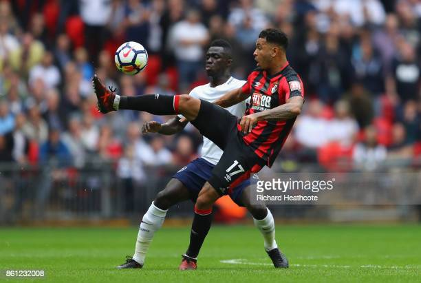 Joshua King of AFC Bournemouth and Davinson Sanchez of Tottenham Hotspur battle for possession during the Premier League match between Tottenham...