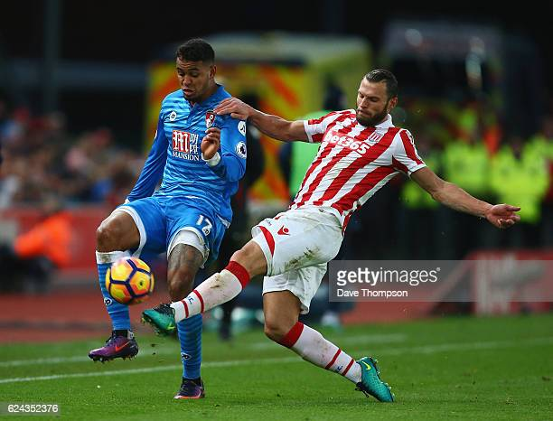 Joshua King of AFC Bournemouth and Erik Pieters of Stoke City battle for possession during the Premier League match between Stoke City and AFC...