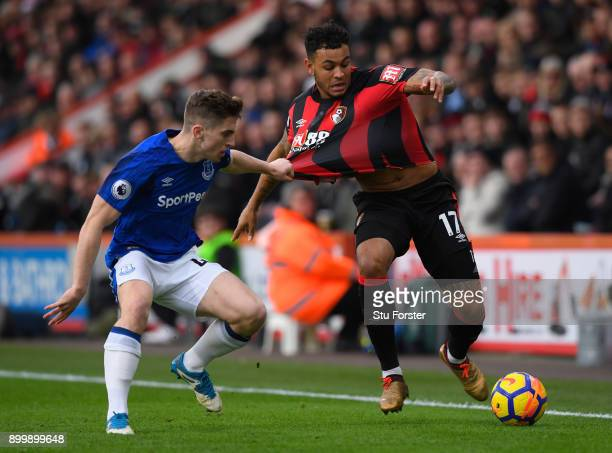 Joshua King of AFC Bournemouth and Jonjoe Kenny of Everton battle for the ball during the Premier League match between AFC Bournemouth and Everton at...
