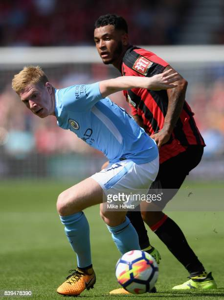 Joshua King of AFC Bournemouth and Kevin De Bruyne of Manchester City battle for possession during the Premier League match between AFC Bournemouth...