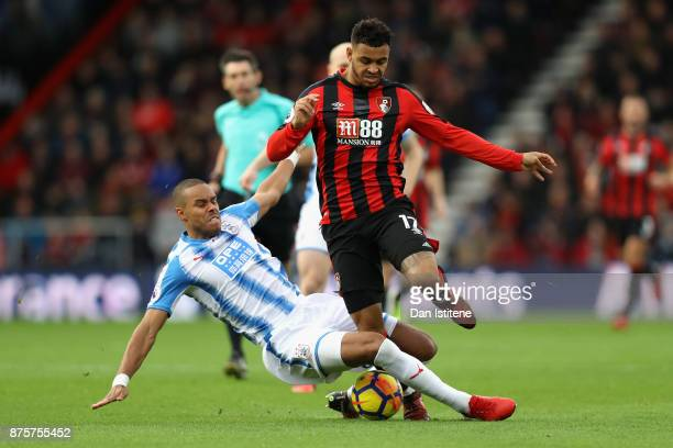 Joshua King of AFC Bournemouth and Mathias Jorgensen of Huddersfield Town during the Premier League match between AFC Bournemouth and Huddersfield...