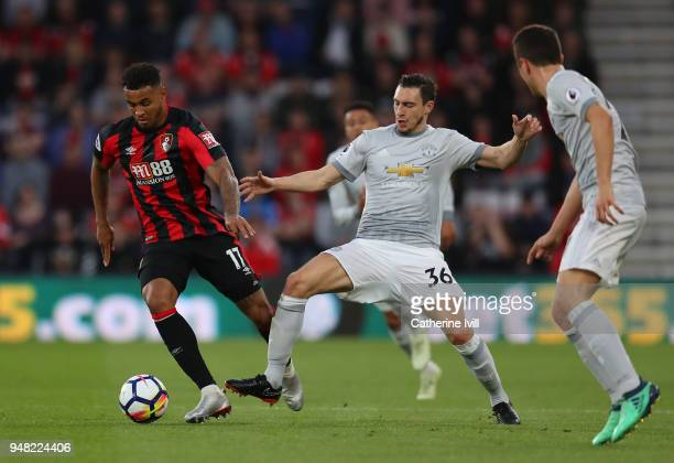 Joshua King of AFC Bournemouth and Matteo Darmian of Manchester United battle for possession during the Premier League match between AFC Bournemouth...