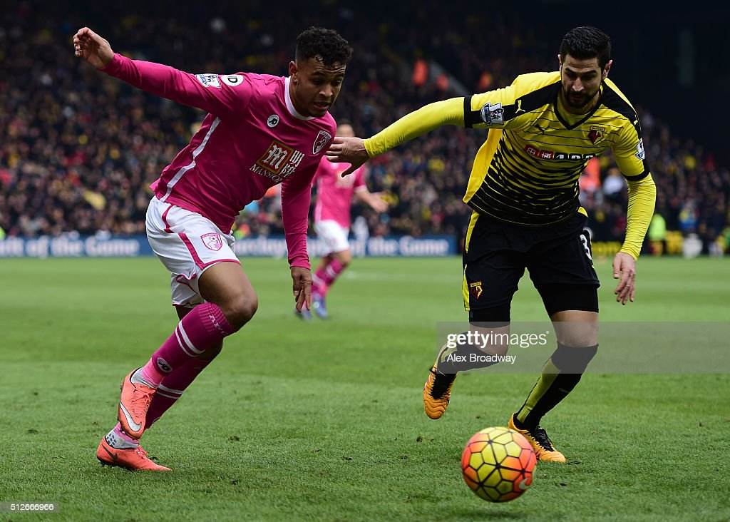 Joshua King of A.F.C Bournemouth and Miguel Angel Britos of Watford contest the ball during the Barclays Premier League match between Watford and A.F.C Bournemouth at Vicarage Road on February 27, 2016 in Watford, England.
