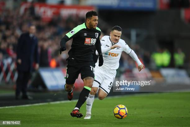 Joshua King of AFC Bournemouth and Roque Mesa of Swansea City battle for possession during the Premier League match between Swansea City and AFC...
