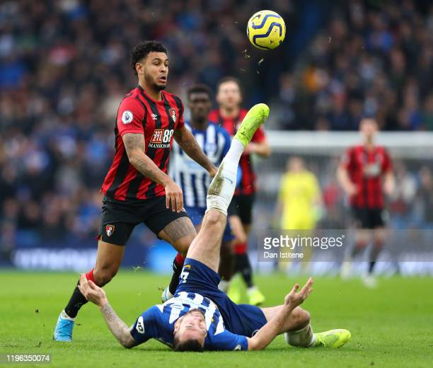 Joshua King of AFC Bournemouth and Shane Duffy of Brighton & Hove Albion challenge for the ball during the Premier League match between Brighton &...