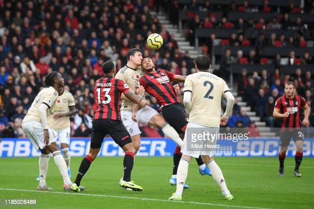 Joshua King of AFC Bournemouth battles for possession with Harry Maguire of Manchester United during the Premier League match between AFC Bournemouth...