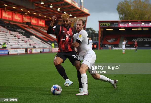 Joshua King of AFC Bournemouth battles for possession with Matthew Clarke of Derby County during the Sky Bet Championship match between AFC...
