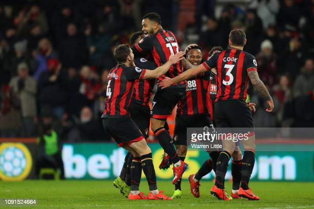Joshua King of AFC Bournemouth celebrates after scoring his team's third goal with team mates during the Premier League match between AFC Bournemouth...