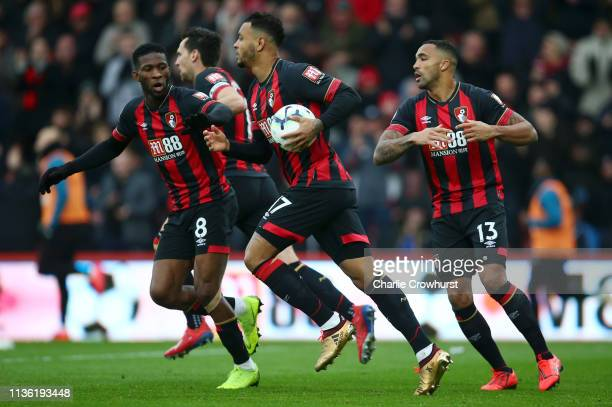 Joshua King of AFC Bournemouth celebrates after scoring his team's first goal with Jefferson Lerma of AFC Bournemouth during the Premier League match...