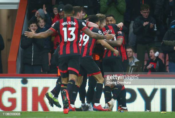 Joshua King of AFC Bournemouth celebrates after scoring his team's second goal with his team mates during the Premier League match between AFC...