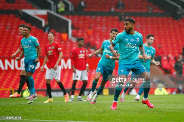 Joshua King of AFC Bournemouth celebrates after scoring his team's second goal from a penalty during the Premier League match between Manchester...