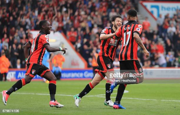 Joshua King of AFC Bournemouth celebrates Ryan Shawcross of Stoke City scoring a own goal for AFC Bournemouth's second goal with Harry Arter of AFC...