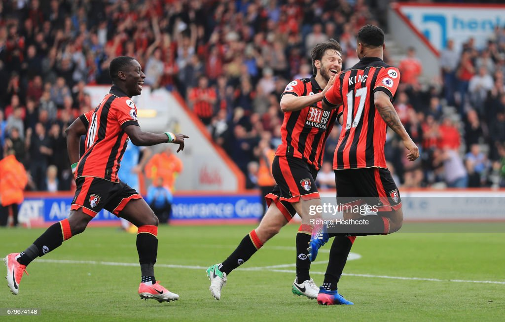 Joshua King of AFC Bournemouth celebrates Ryan Shawcross of Stoke City (not pictured) scoring a own goal for AFC Bournemouth's second goal with Harry Arter of AFC Bournemouth and Max Gradel of AFC Bournemouth during the Premier League match between AFC Bournemouth and Stoke City at the Vitality Stadium on May 6, 2017 in Bournemouth, England.