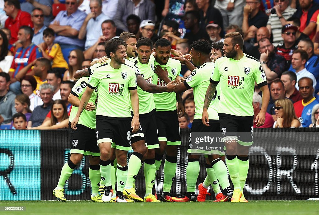 Joshua King of AFC Bournemouth celebrates scoring his sides first goal with team mates during the Premier League match between Crystal Palace and AFC Bournemouth at Selhurst Park on August 27, 2016 in London, England.