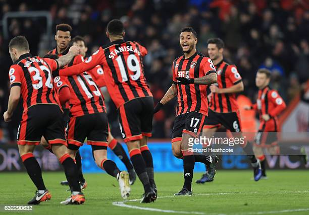 Joshua King of AFC Bournemouth celebrates scoring his sides first goal with his AFC Bournemouth team mates during the Premier League match between...