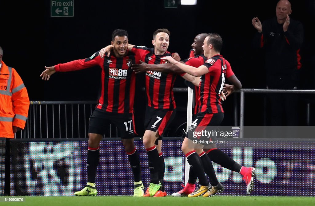 Joshua King of AFC Bournemouth celebrates scoring his sides first goal with team mates during the Carabao Cup Third Round match between AFC Bournemouth and Brighton and Hove Albion at Vitality Stadium on September 19, 2017 in Bournemouth, England.