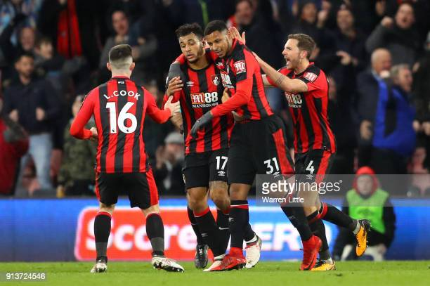 Joshua King of AFC Bournemouth celebrates scoring his side's first goal with team mates during the Premier League match between AFC Bournemouth and...