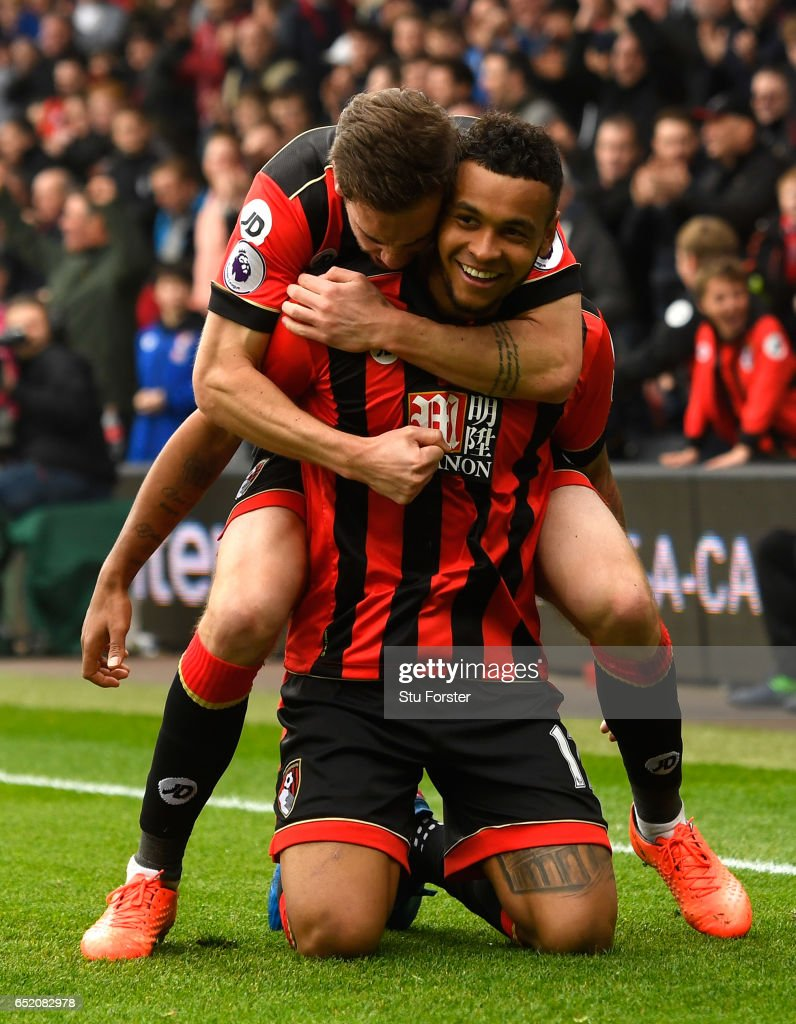 Joshua King of AFC Bournemouth celebrates scoring his sides second goal with Dan Gosling during the Premier League match between AFC Bournemouth and West Ham United at Vitality Stadium on March 11, 2017 in Bournemouth, England.