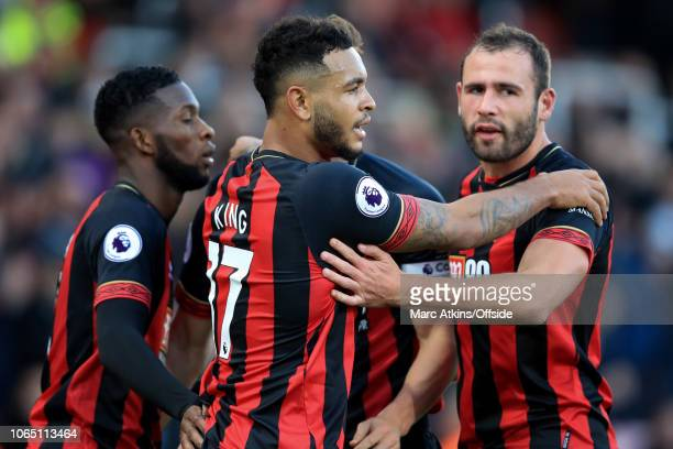 Joshua King of AFC Bournemouth celebrates scoring the equalising goal with team mates during the Premier League match between AFC Bournemouth and...