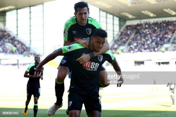 Joshua King of AFC Bournemouth celebrates with Charlie Daniels of AFC Bournemouth after scoring his sides first goal during the Premier League match...
