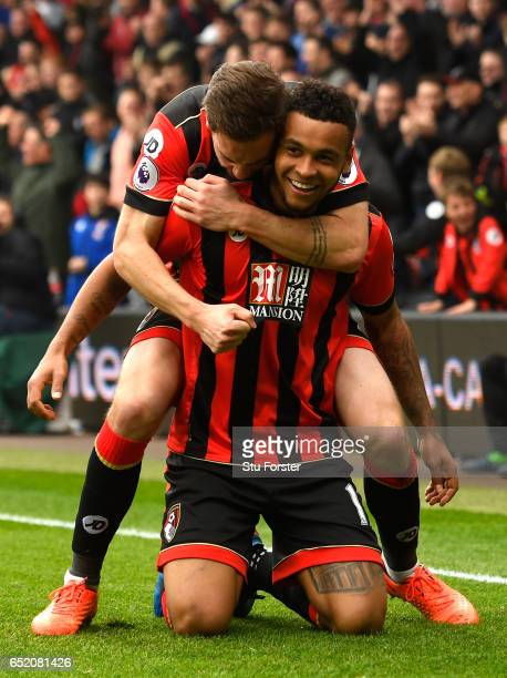Joshua King of AFC Bournemouth celebrates with Dan Gosling as he scores their second goal during the Premier League match between AFC Bournemouth and...