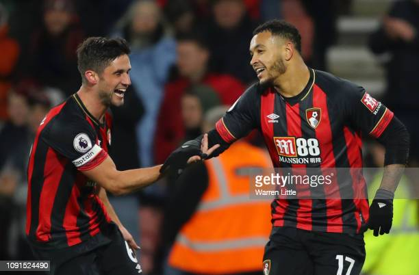 Joshua King of AFC Bournemouth celebrates with teammate Andrew Surman after scoring his team's third goal during the Premier League match between AFC...