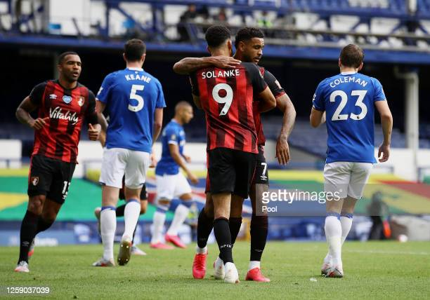Joshua King of AFC Bournemouth celebrates with teammate Dominic Solanke after scoring his team's first goal during the Premier League match between...