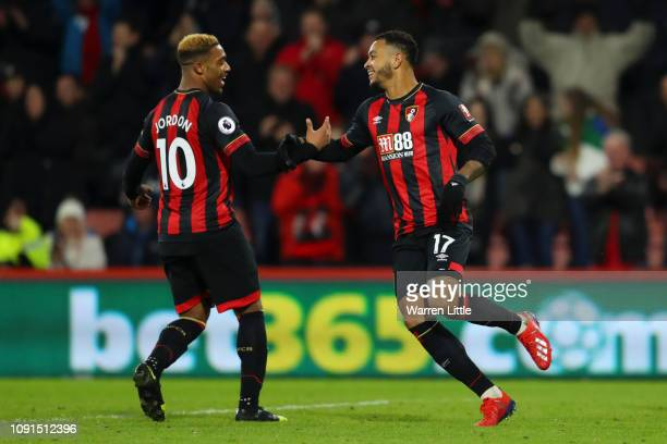 Joshua King of AFC Bournemouth celebrates with teammate Jordon Ibe after scoring his team's third goal during the Premier League match between AFC...