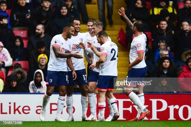 Joshua King of AFC Bournemouth celebrates with teammates after scoring his team's third goal during the Premier League match between Watford FC and...