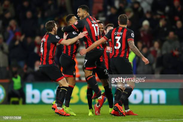 Joshua King of AFC Bournemouth celebrates with teammates after scoring his team's third goal during the Premier League match between AFC Bournemouth...