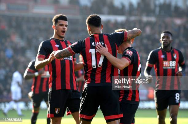 Joshua King of AFC Bournemouth celebrates with teammates after scoring his team's first goal from the penalty spot during the Premier League match...
