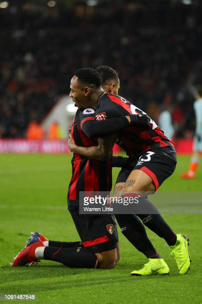 Joshua King of AFC Bournemouth celebrates with teammmate Nathaniel Clyne after scoring his team's first goal during the Premier League match between...