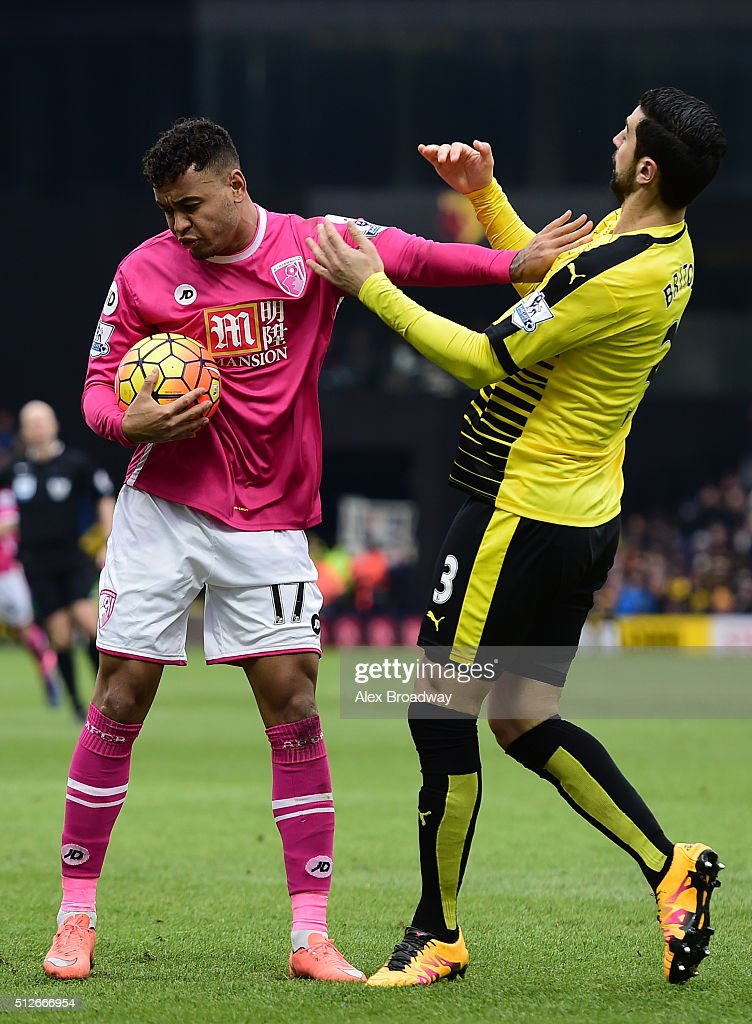 Joshua King of A.F.C Bournemouth clashes with Miguel Angel Britos of Watford during the Barclays Premier League match between Watford and A.F.C Bournemouth at Vicarage Road on February 27, 2016 in Watford, England.