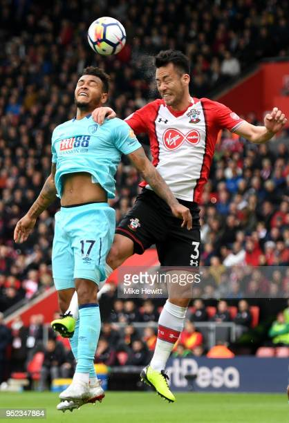 Joshua King of AFC Bournemouth competes for a header with Maya Yoshida of Southampton during the Premier League match between Southampton and AFC...