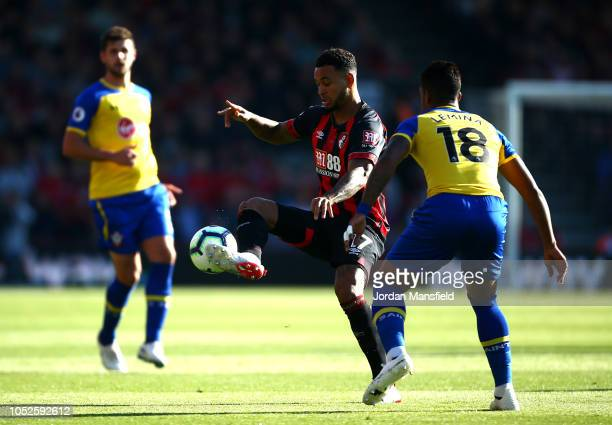 Joshua King of AFC Bournemouth controls the ball while under pressure from Mario Lemina of Southampton during the Premier League match between AFC...