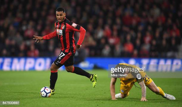 Joshua King of AFC Bournemouth evades Shane Duffy of Brighton and Hove Albion during the Premier League match between AFC Bournemouth and Brighton...