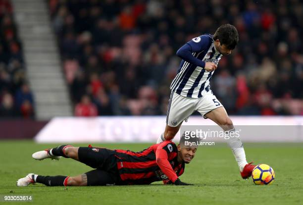 Joshua King of AFC Bournemouth goes down as Claudio Yacob of West Bromwich Albion runs with the ball during the Premier League match between AFC...
