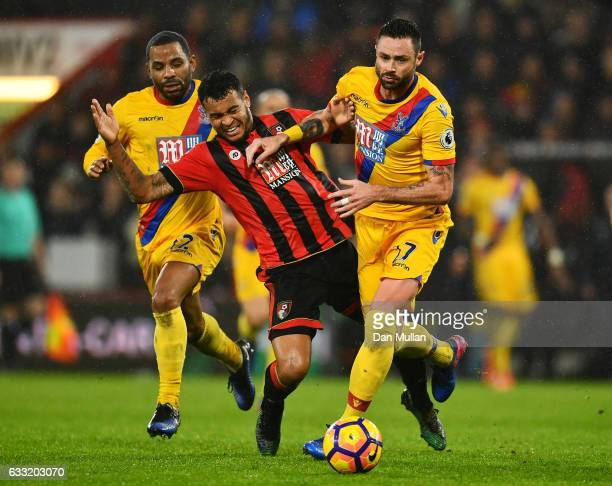 Joshua King of AFC Bournemouth is challenged by Damien Delaney of Crystal Palace during the Premier League match between AFC Bournemouth and Crystal...